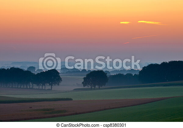 Magical sunrise over hillside agricultural country - csp8380301
