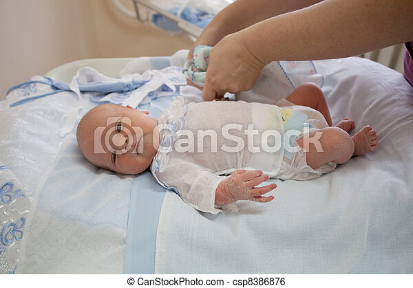 baby at the age of 4 days prepare in an extract from maternity hospital. - csp8386876