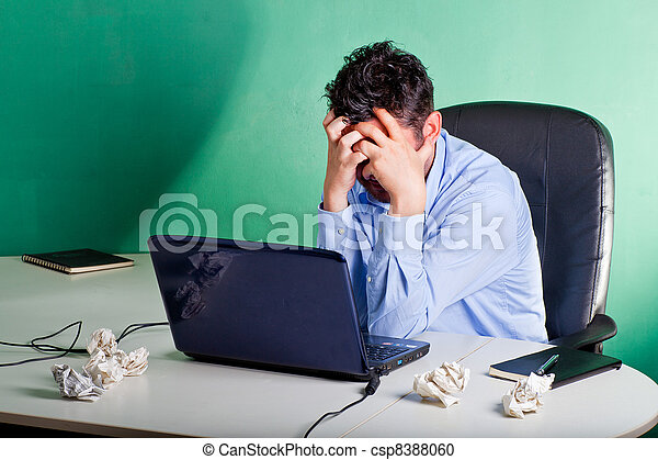 Frustrated businessman in his office - csp8388060
