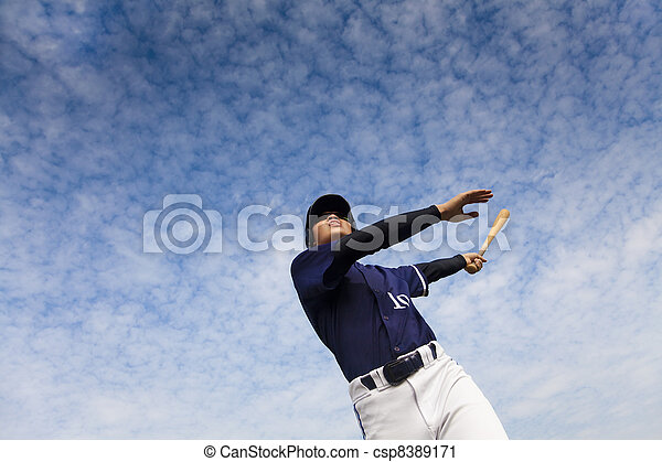 young baseball player taking a swing  - csp8389171