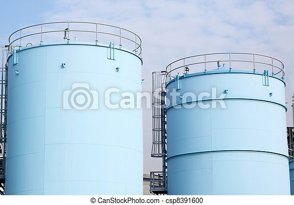 large white tanks for petrol and oil in the Rotterdam harbor - csp8391600