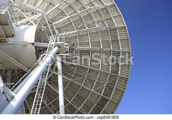 Radar dish with blue sky - csp8391859