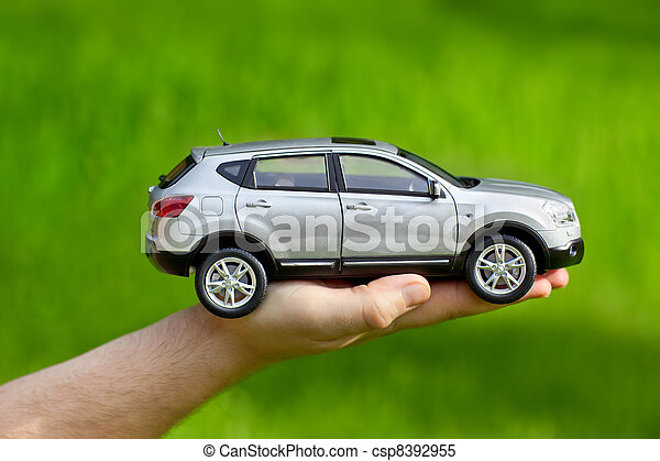 Hand with toy car - csp8392955