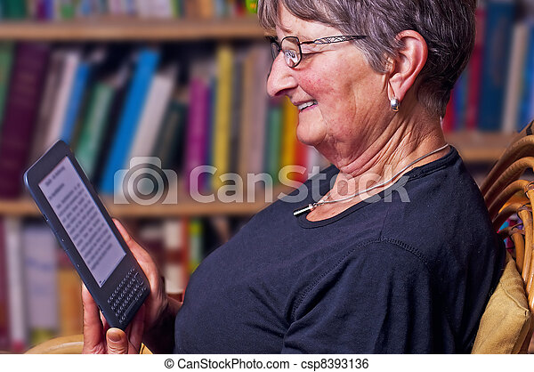 pensioner with e-book reader - csp8393136