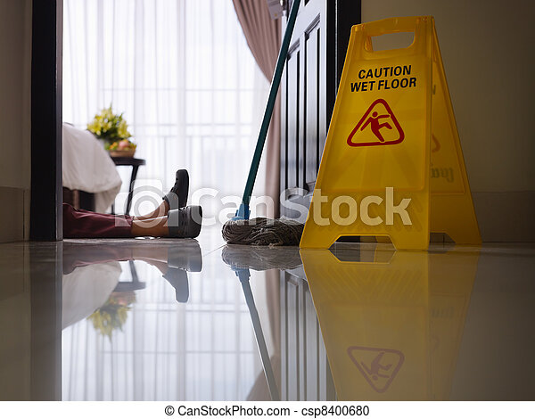 maid slipped on wet floor and layin - csp8400680