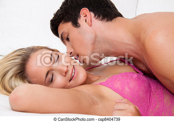 couple in bed during sex and tenderness - csp8404739