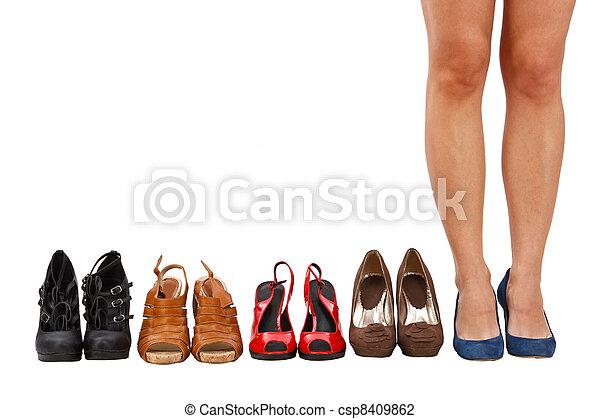 woman buy shoes concept - csp8409862