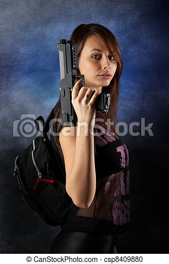 freestyle woman posing with guns - csp8409880
