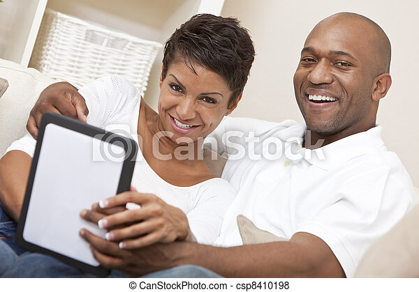 African American Man Woman Couple Using Tablet Computer - csp8410198