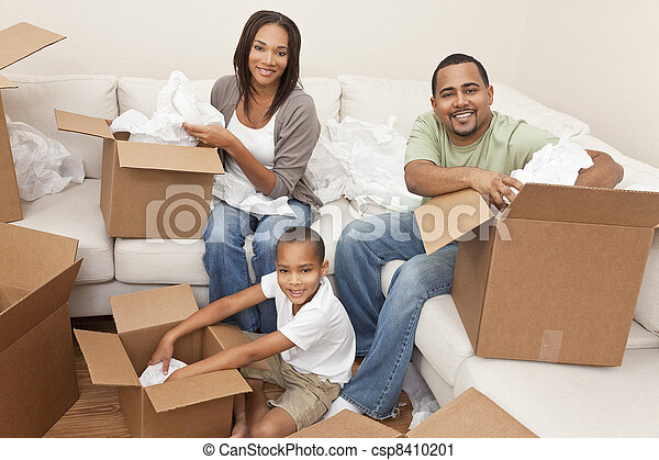 African American Family Unpacking Boxes Moving House - csp8410201
