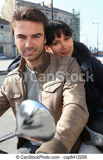 Couple on a moped - csp8412295