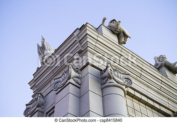 Classical style columns in ionic order on exterior of modern building. - csp8415840