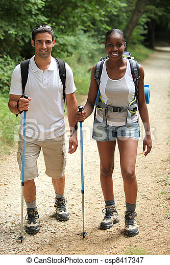 Couple walking in the countryside - csp8417347