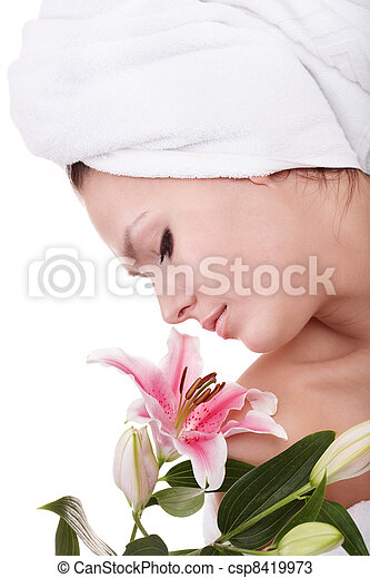 Young woman on massage table in beauty spa. - csp8419973