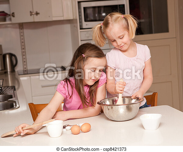 Kids baking muffins in a kitchen - csp8421373