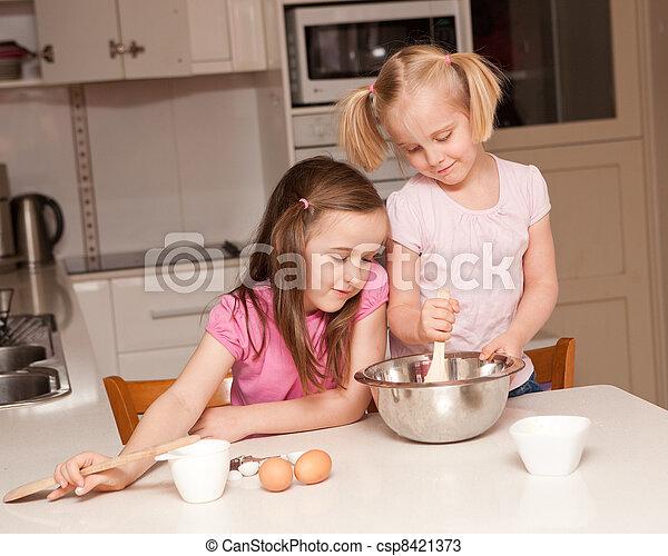 Kids baking muffins in a kitchen - csp8421373