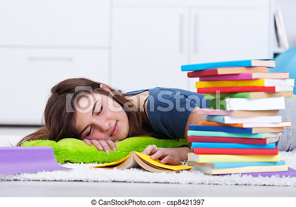 Teenager asleep by the book - csp8421397