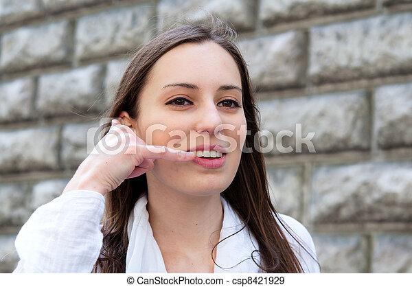 woman talk on a cellular telephone  - csp8421929