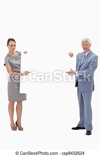 White hair businessman holding and pointing to a big white sign with a woman against white background - csp8432624