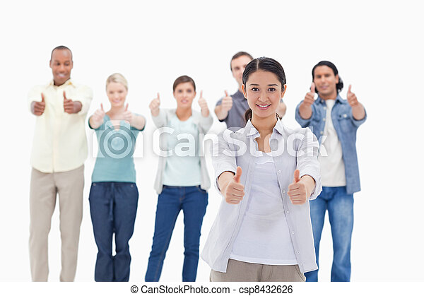 Close-up of people smiling with their thumbs-up - csp8432626