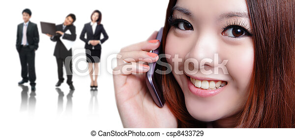 Young business woman speaking mobile phone with sweet smile - csp8433729