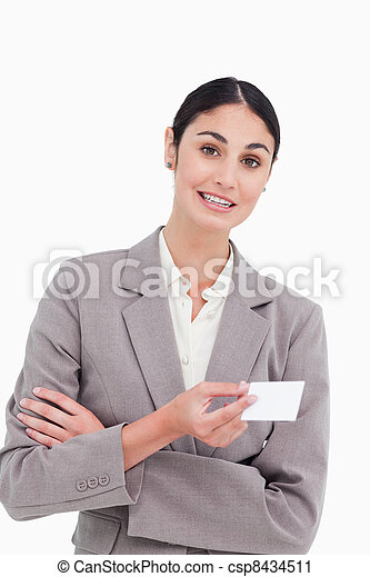 Saleswoman with arms folded and business card - csp8434511