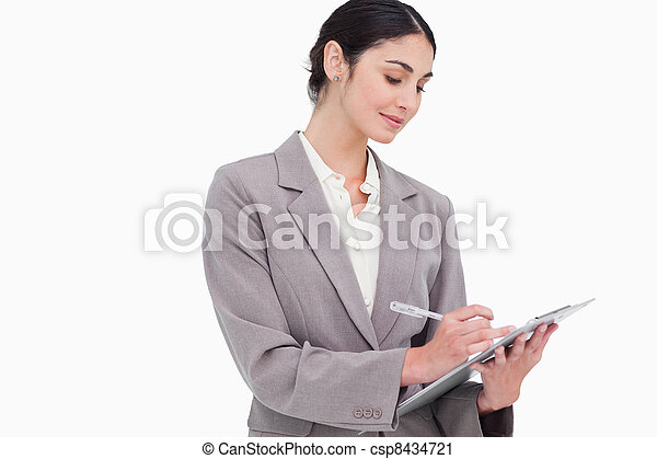 Businesswoman taking notes - csp8434721