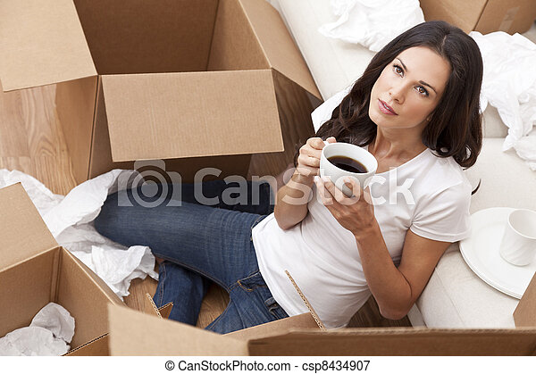 Woman Drinking Coffee Unpacking Boxes Moving House - csp8434907