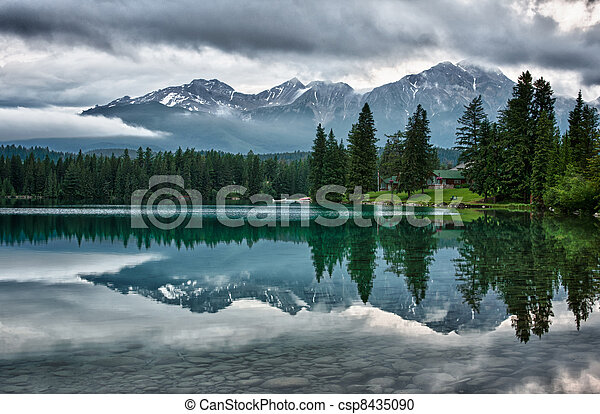 Foggy morning over Canadian Rocky Mountains perfectly mirrors - csp8435090