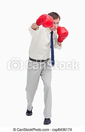 Businessman attacking with boxing gloves - csp8436174