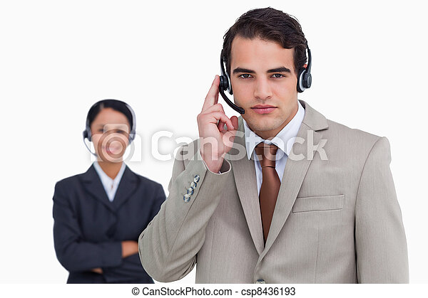 Hotline employee with colleague behind him - csp8436193