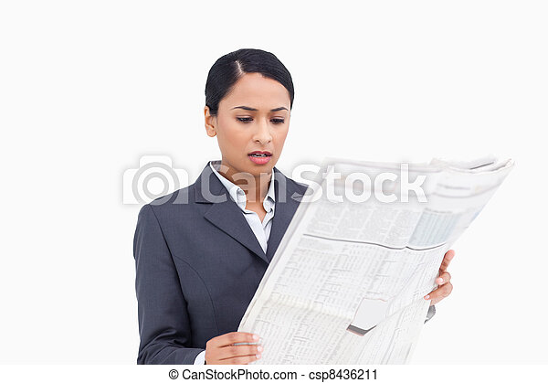 Close up of saleswoman reading news paper - csp8436211