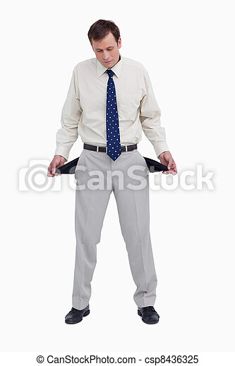 Bankrupt businessman showing his empty pockets - csp8436325