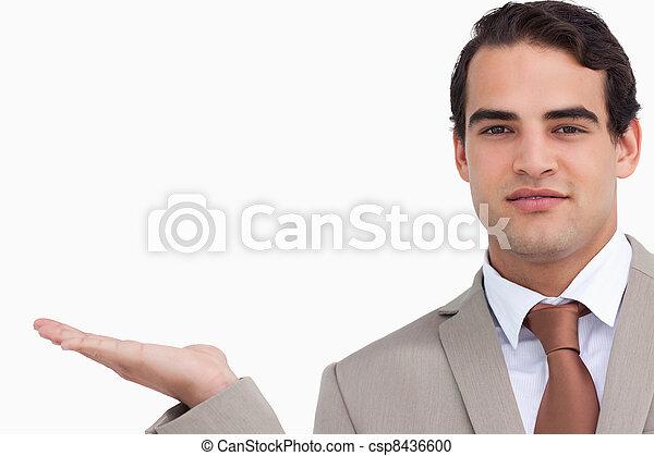 Close up of salesman holding palm up - csp8436600