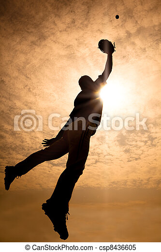 The silhouette of baseball player jumping into air to make the catch - csp8436605
