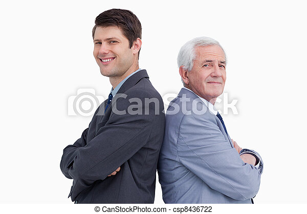 Close up of businessman and his mentor standing back to back - csp8436722