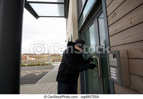 Man unlocking the door to the office - csp8437554