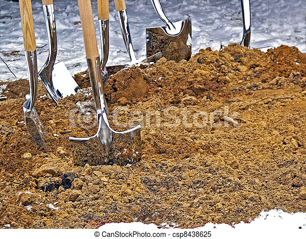 shiny shovels in dirt - csp8438625