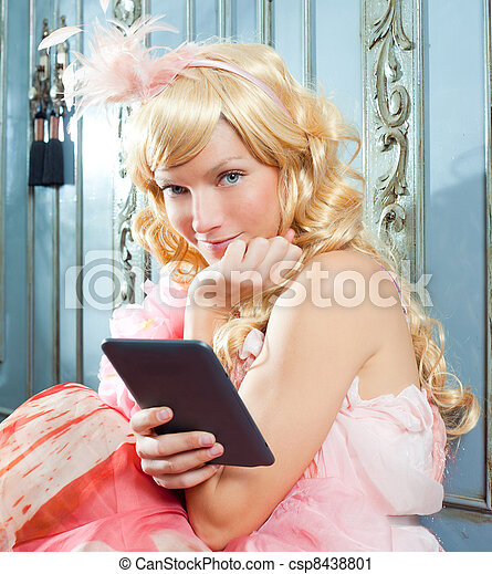 blond fashion princess woman reading ebook tablet - csp8438801