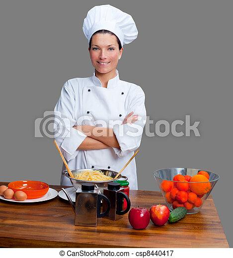 Chef woman portrait with white uniform - csp8440417