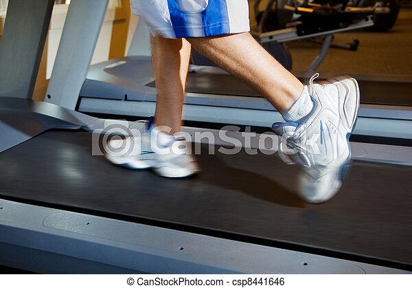 Man Running on Treadmill - csp8441646