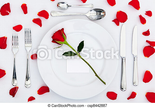Place setting with red rose and petals - csp8442887