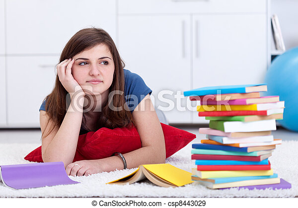 Daydreaming by the school books - csp8443029
