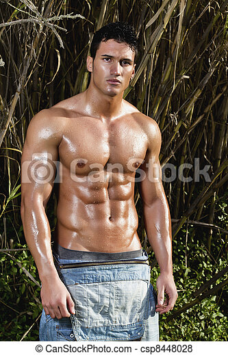 male model with muscles on the countryside - csp8448028