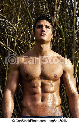 male model with muscles on the countryside - csp8448046