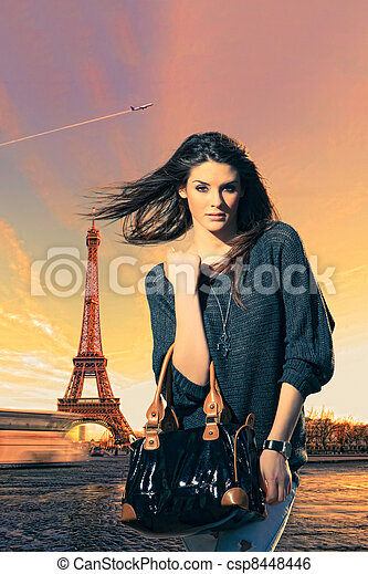 Woman visiting Paris in France with the Eiffel tower - csp8448446