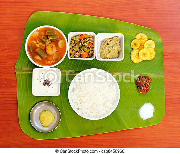 Traditional southern-indian meals on plantain leaf - csp8450960
