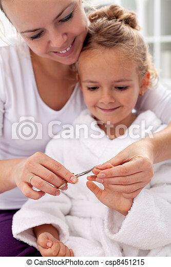 Cutting fingernails after bath - csp8451215