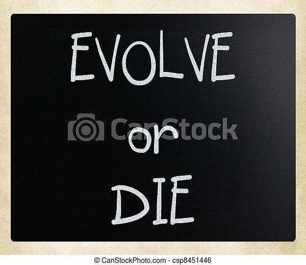"""""""Evolve or Die"""" handwritten with white chalk on a blackboard - csp8451446"""