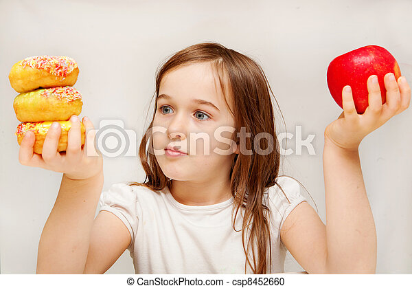 This photo depicts a young girl making decisions betwen healthy y food and unhealthy food.   - csp8452660